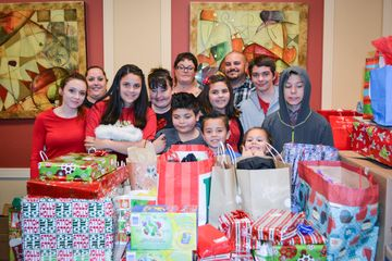 Dunkin' Donuts Bringing Joy: Las Vegas DD Employees Bring Joy to Children with Annual Adopt-A-Family Program