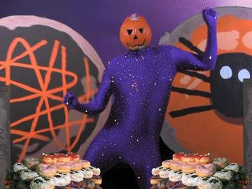 Dancing Pumpkin Man Celebrates Dunkin's New Dressed Up Halloween Donuts