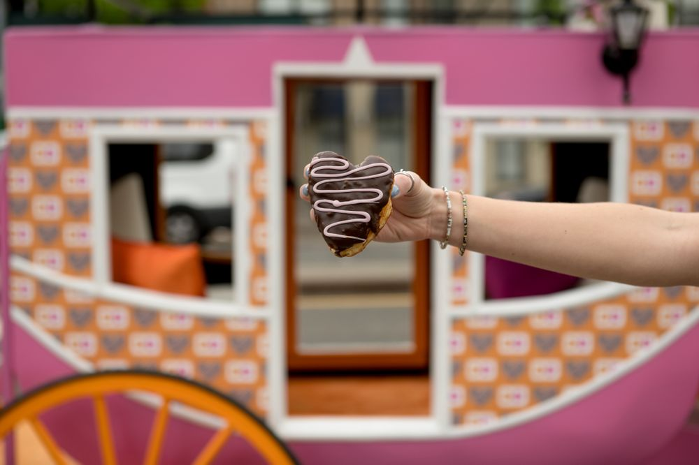 Princess Carole Radziwill Surprises Guests in Dunkin'-Inspired Royal Carriage