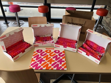 Assembled masks in Dunkin' boxes
