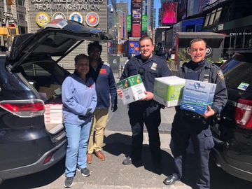 Franchisees Miten Patel and Caryn Battaglia donated over 36,000 pairs of plastic gloves to Manhattan South precinct delegates in Times Square.