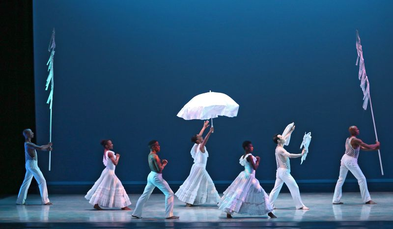 Alvin Ailey American Dance Theater in Alvin Ailey's Revelations. Photo by Donna Ward