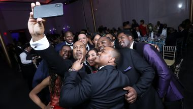 AAADT Dancers and Guests take a selfie with Artistic Director Robert Battle. Photo © Tony Powell