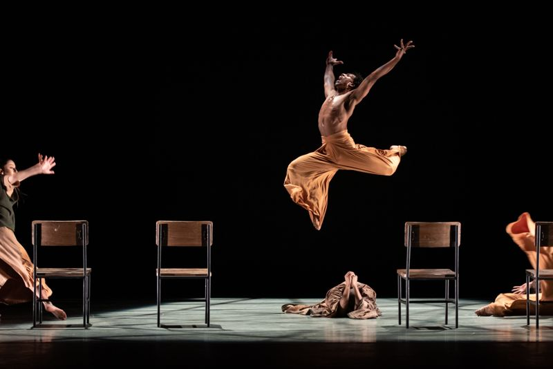 Ailey II's Marcus Williams and company in Robert Battle's Flock. Photo by Nan Melville