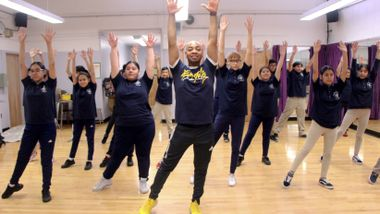 AIE Teaching Artist Cedric Green leads AileyDance Kids at Dual Language Middle School