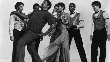 Alvin Ailey (front left) with company members including  Masazumi Chaya (far right) during a rehearsal of Donald McKayle's District Storyville. Photo by Jack Mitchell. (©) Alvin Ailey Dance Foundation, Inc. and Smithsonian Institution