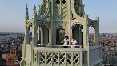 Ailey's Jacqueline Green and Yannick Lebrun at the top of The Woolworth Building. Photo by Mikey Pozarik
