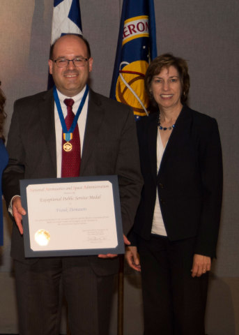 Orbital ATK's Frank DeMauro receives the NASA Exceptional Public Service Medal from Johnson Space Ce ...
