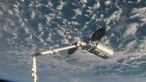 The International Space Station   s robotic arm is seen grappling Orbital ATK   s Cygnus spacecraft on M ...