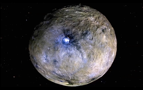 The dwarf planet Ceres is shown, including bright features revealed by Dawn at the Occator Crater th ...