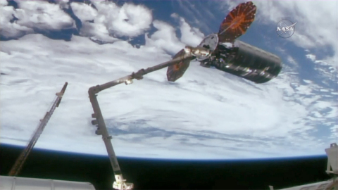 The International Space Station   s robotic arm is seen grappling Orbital ATK   s Cygnus cargo spacecraf ...