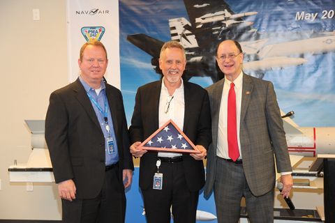 Gordon Tuner VP Strategy and Business Development Cary Ralston VP and GM U.S. Representative Brad Sherman presenting U.S. flag
