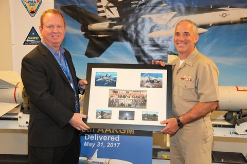 Gordon Turner presents Capt Mousseau an AARGM memento