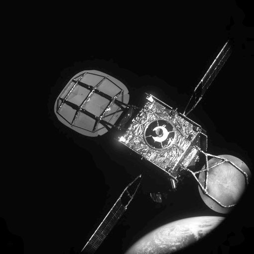 """View of IS-901 satellite from MEV-1's """"near hold"""" position during approach from approximately 20 meters with Earth in the background."""