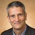 close-in headshot of Jon Hennebold, Ph.D., a grey-haired man