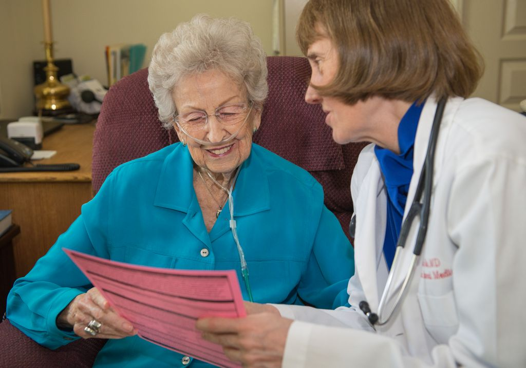 older woman (left) talking with dr. susan tolle