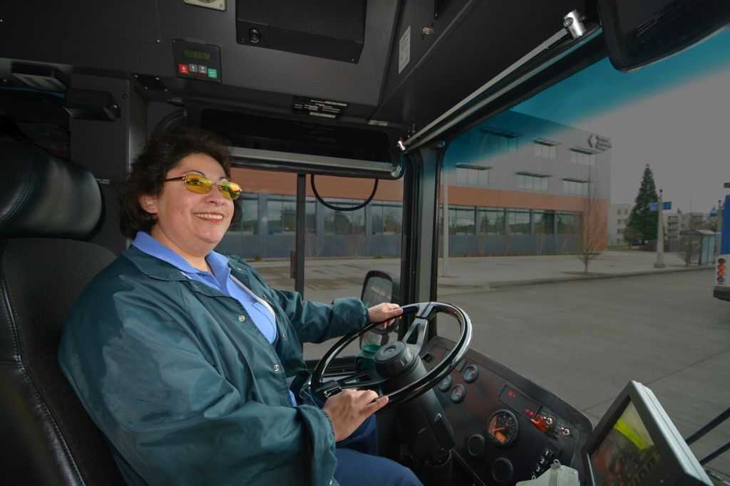 female bus driving, driving a bus