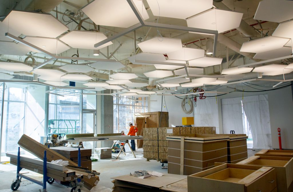 room under construction, with large walls of glass