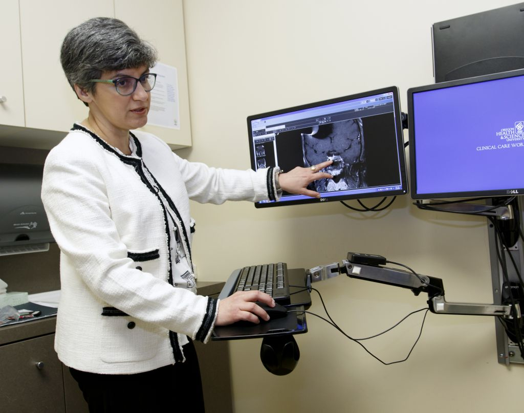 doctor looking at brain scan on computer