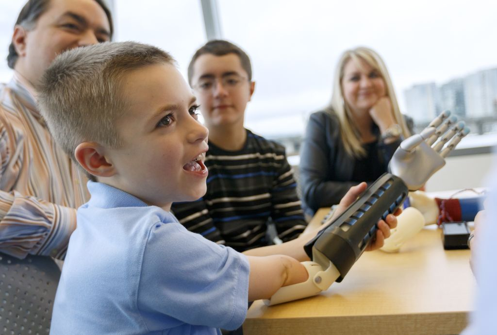 young boy wearing a prosthetic bionic arm
