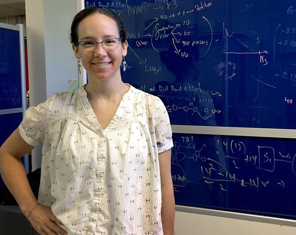 woman standing near chalkboard