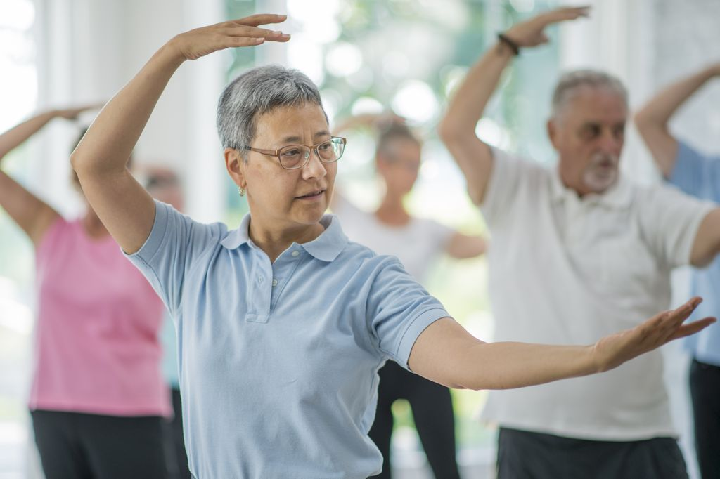 group of seniors doing tai-chi