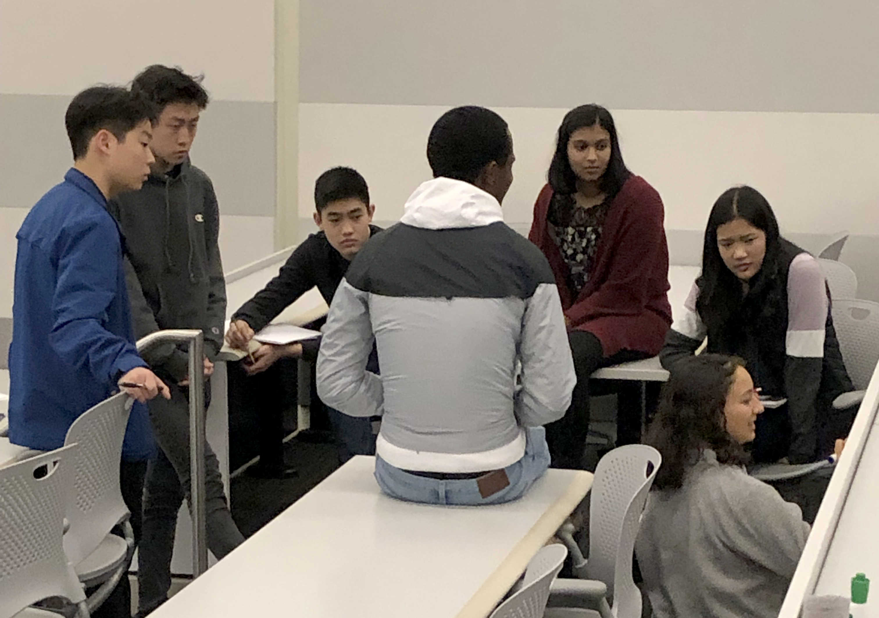 PSI students discussing research