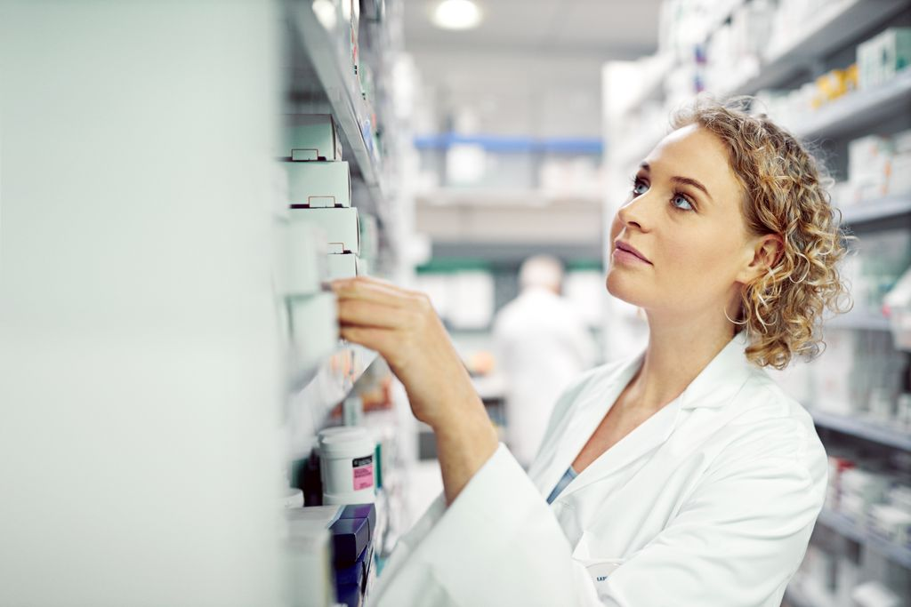 pharmacist pulling drugs from a shelf