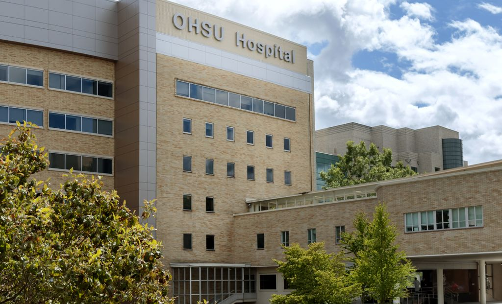 OHSU Hospital, tan brick building, with flag
