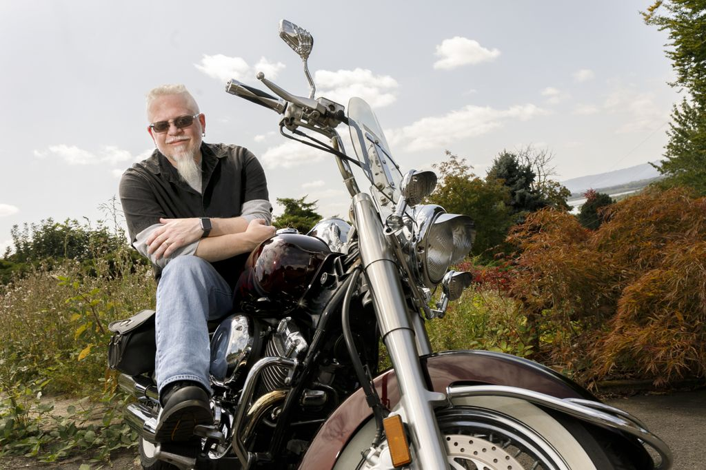 Brian Matekovich, sitting on his motorcycle and looking at camera