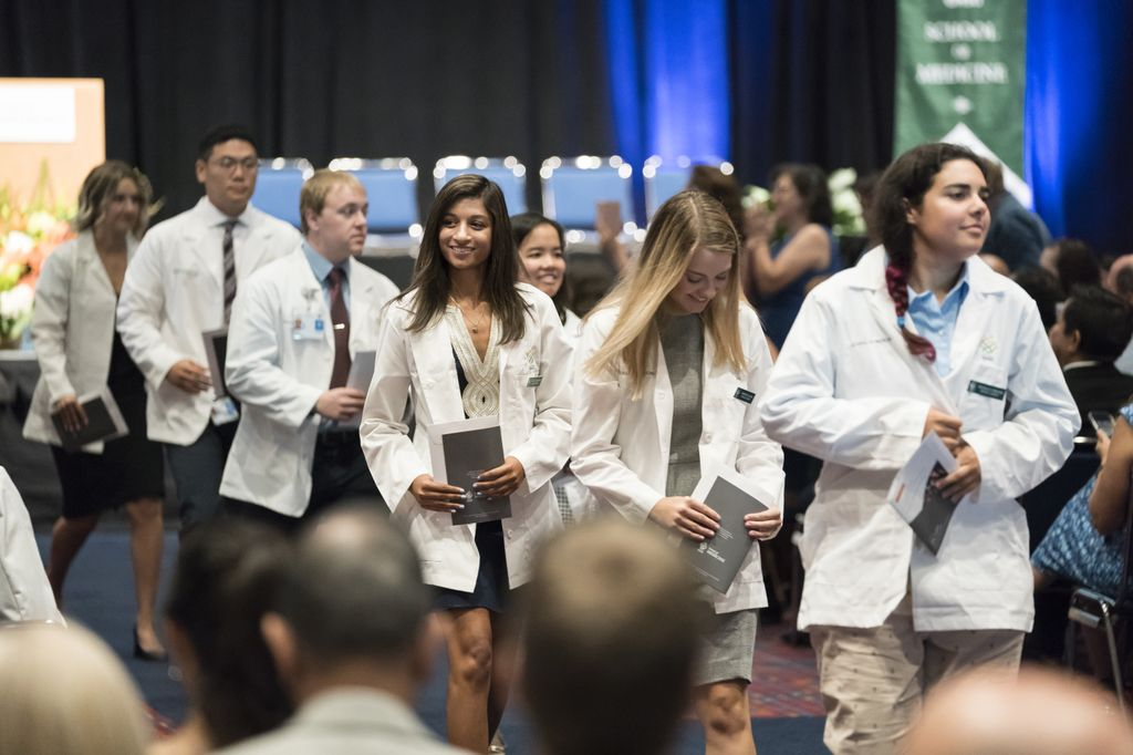 students wearing white coats