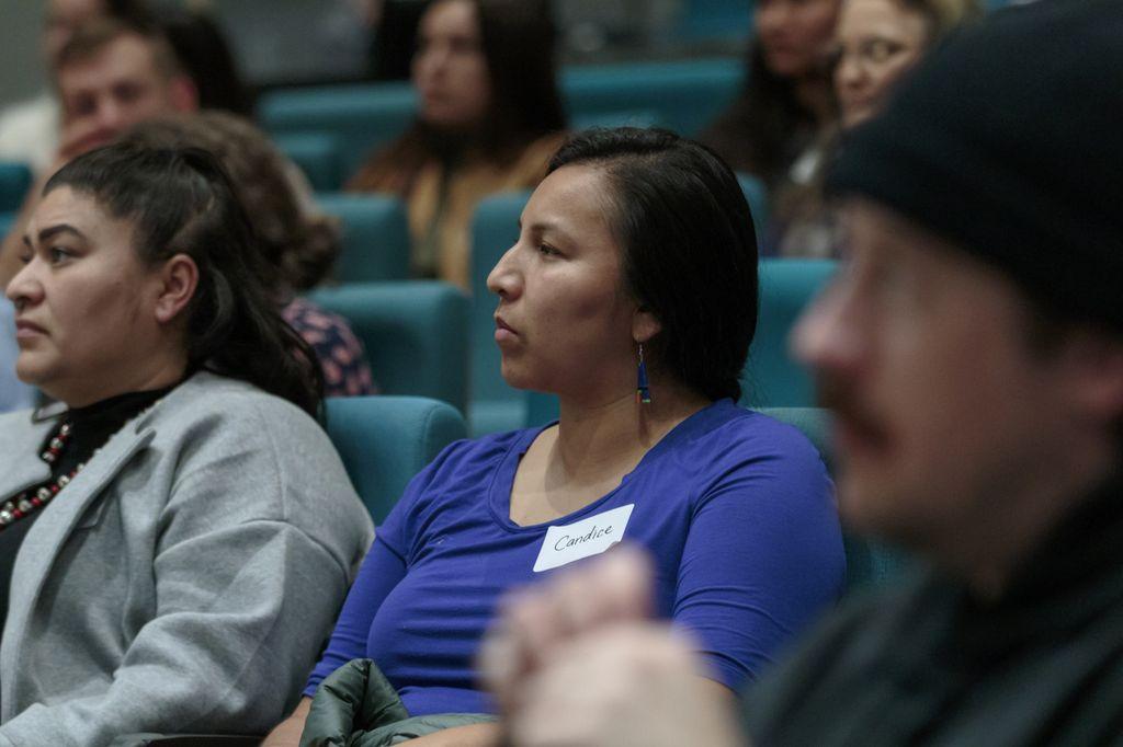 audience members listening to houska