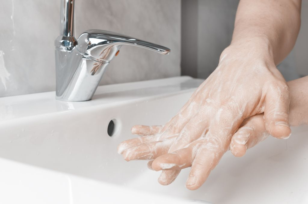 closeup of person's hands as they are washing with good technique