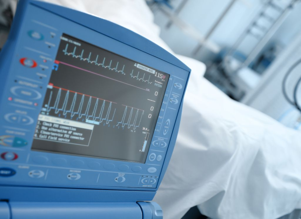 Modern ICU monitor in clinical ward next to the bed of the patient