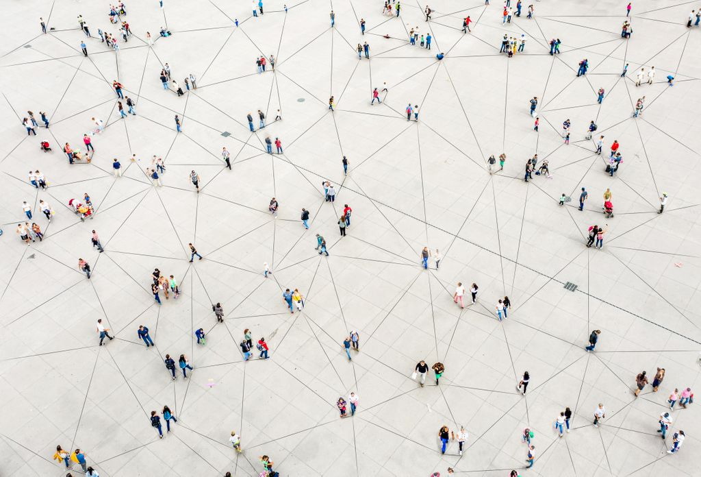 birdseye view of people walking and an overlay of lines connecting them