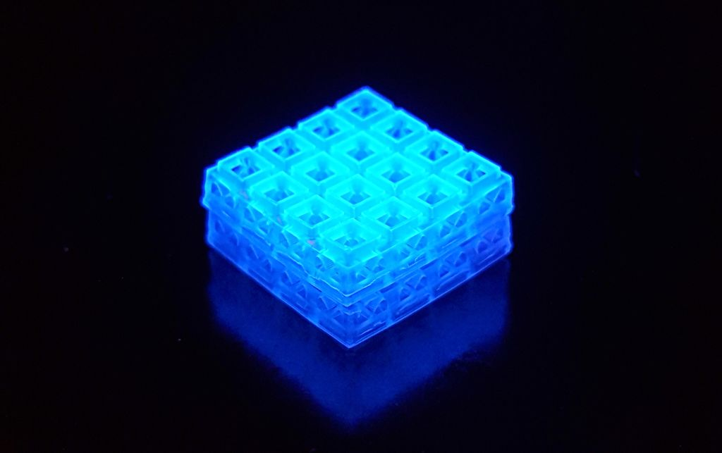 An illuminated block of interlocked 3D printed pieces
