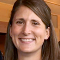 close-in headshot of Caroline King, M.P.H., a smiling woman with long straight hair