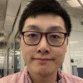 Closeup headshot of (Samuel) Yiu Huen Tsang, Ph.D., an Asian man in glasses and a button-down shirt.
