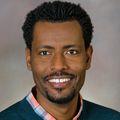 Close-in headshot of Fikadu Tafesse Ph.D, a smiling Black man with short hair