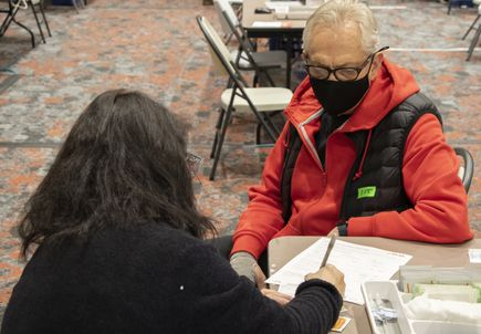 Seniors receive COVID vaccinations