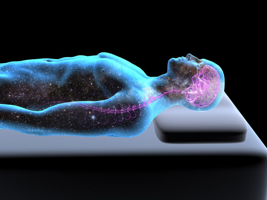 Side view of reclining, sleeping man on a bed, body filled with star field, pink illuminated brain, x-ray style, black background.