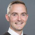 headshot of Bradley Buchheit, M.D., a smiling white man with a flattop haircut