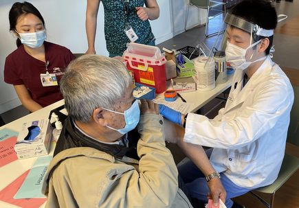 OHSU students help vaccinate Asian American seniors