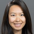 headshot of Jane Zhu, M.D., M.P.P., M.S.H.P., a smiling Asian woman with long black hair