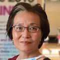 Close-in headshot of Xuan Qin, Ph.D., an Asian adult female wearing glasses