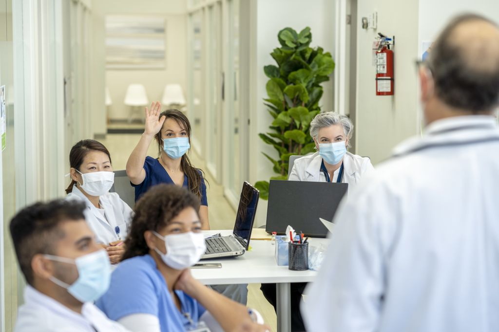 Group of medical students in a medical training class, all are wearing masks due to COVID-19.