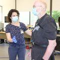 Marian Dale, M.D., M.C.R., works with patient