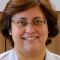 Portrait of Shivaani Kummar M.D. FACP, a bespectacled woman in a white blazer.
