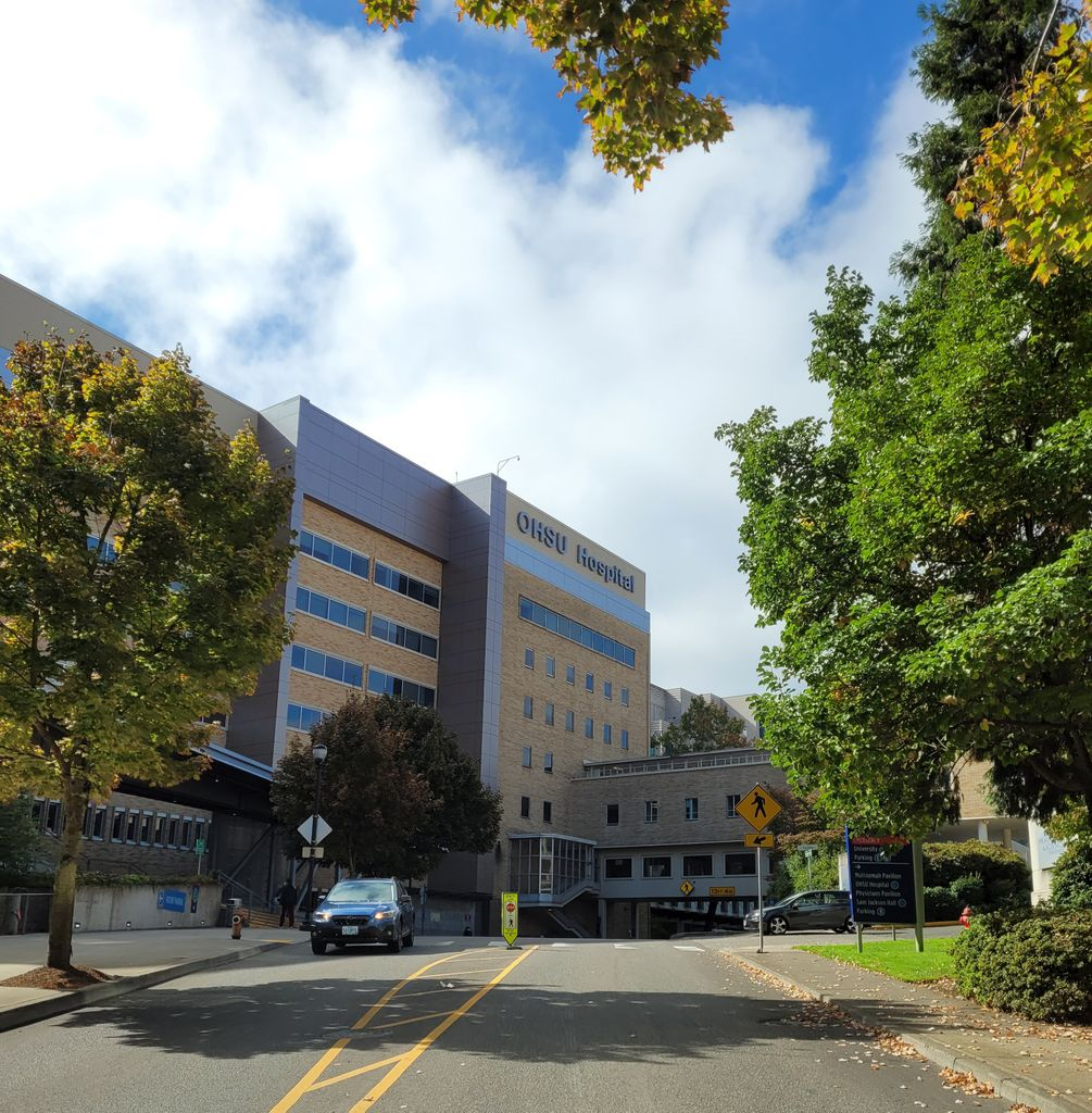 Image of the front of OHSU on a sunny autumn day.
