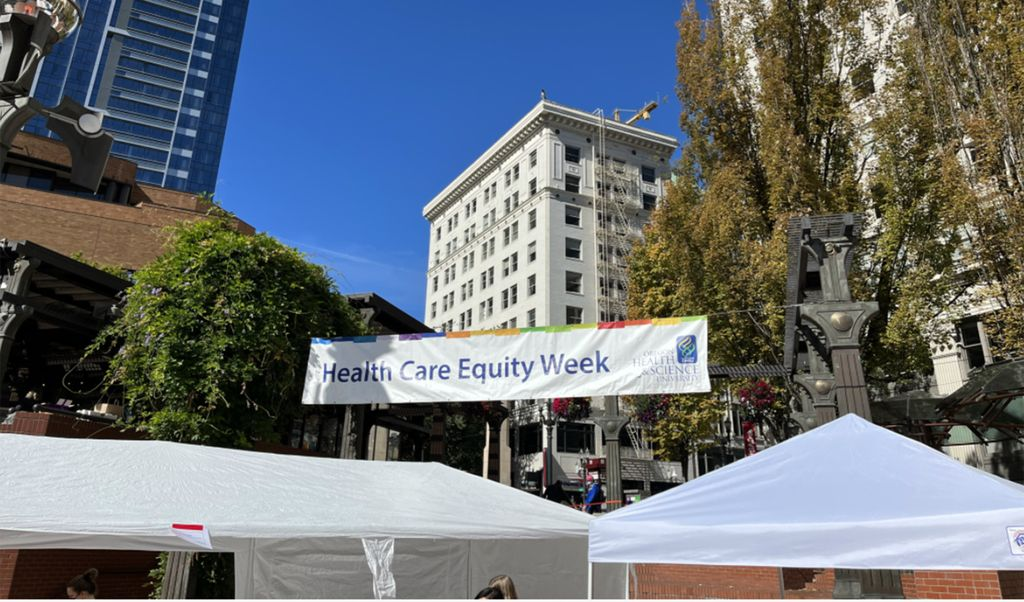 The OHSU Health Care Equity Fair was at Portland's Pioneer Courthouse Square. Image is the fair sign in the square.